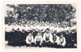Krojovaná skupina - H.O. dievčat a chlapcov. Spevácka skupina viedol pr. Viktor Bros, M. Kosáková